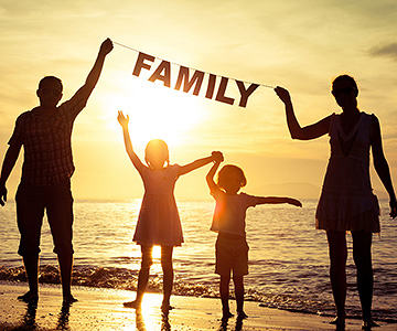 bigstock-happy-family-standing-on-the-beach-300x360