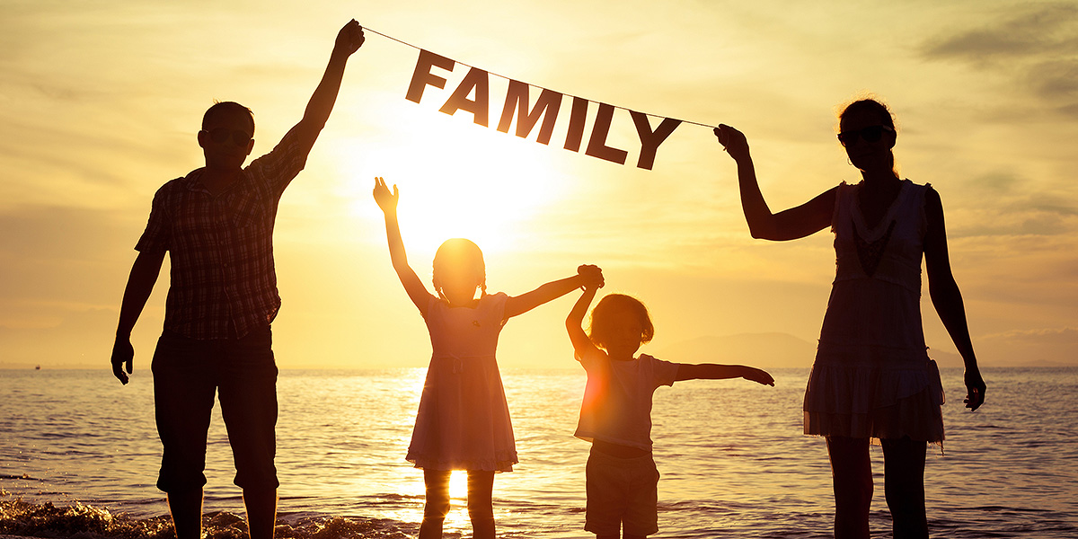 bigstock-happy-family-standing-on-the-beach-1200x600